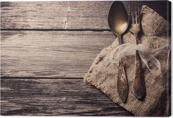 Quadro su Tela Vecchio forchetta e cucchiaio su fondo in legno