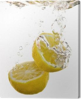 Quadro em Tela 2 Hälften von Zitronen fallen ins Wasser und machen Blasen