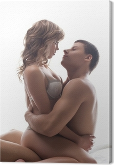 Quadro em Tela Couple playful lovers sit in bed - sexual games