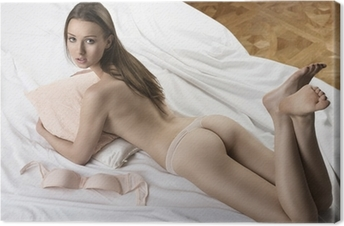 Quadro em Tela Sexy nude girl lying on the white bed with pillow in her arms