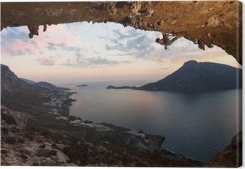 Quadro em Tela Silhouette of a rock climber at sunset. Kalymnos Island, Greece.