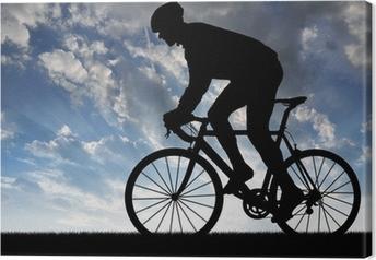 Quadro em Tela silhouette of the cyclist riding a road bike at sunset