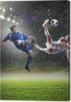 Quadro em Tela two football players striking the ball