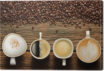 Quadro em Tela Variety of cups of coffee and coffee beans on old wooden table