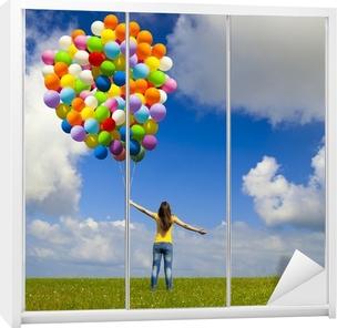 Schrankaufkleber Mädchen mit bunten Luftballons
