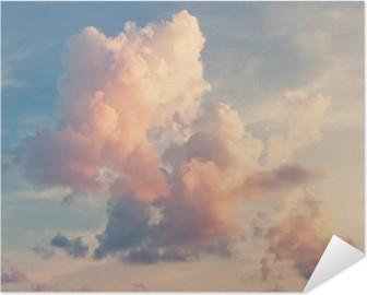 Selbstklebendes Poster Rosa Wolken auf blauem Himmel