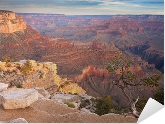 Selbstklebendes Poster Sonnenaufgang über dem Grand Canyon