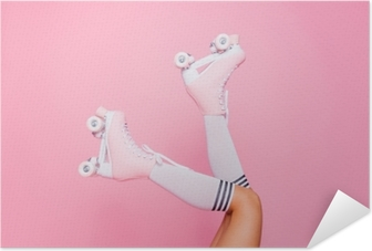 Close up photo of woman's body part. Legs wearing cute sweet with shoelaces four wheeled roller blades isolated tanned bright vivid background Self-Adhesive Poster