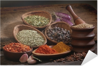 Different spices over a wood background. Self-Adhesive Poster