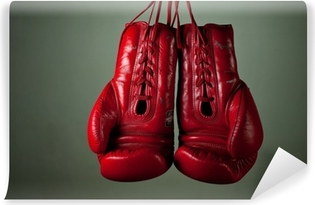 Boxing gloves hanging from laces on a grey background Self-Adhesive Wall Mural