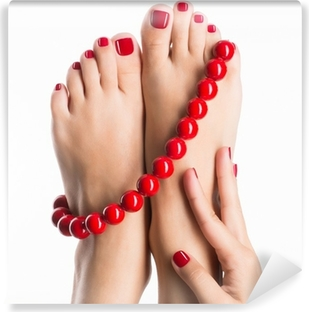 Closeup photo of a female feet with beautiful red pedicure Self-Adhesive Wall Mural