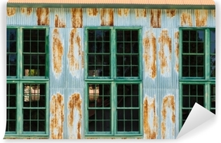 Corrugated tin wall with windows and rust Self-Adhesive Wall Mural