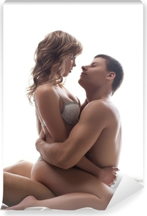 Couple playful lovers sit in bed - sexual games Self-Adhesive Wall Mural