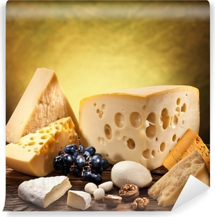 Different types of cheese over old wooden table. Self-Adhesive Wall Mural