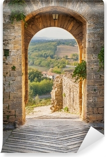 Exit the town of Monteriggioni with views of the Tuscan landscap Self-Adhesive Wall Mural