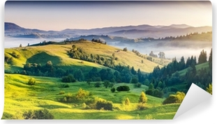 Green hills and mountains in the distance Self-Adhesive Wall Mural