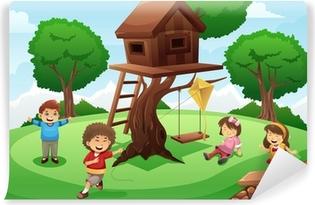 Kids playing around tree house Self-Adhesive Wall Mural