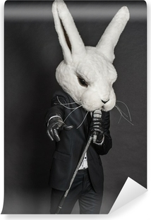 man in rabbit mask . black suit sing on dark background Self-Adhesive Wall Mural