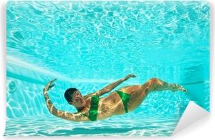 Underwater woman portrait with green bikini in swimming pool. Self-Adhesive Wall Mural