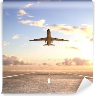 Flyvemaskine på landingsbanen Selvklæbende fototapet