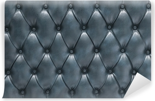 Superficie tapizada de cuero acolchado azul Selvklæbende fototapet