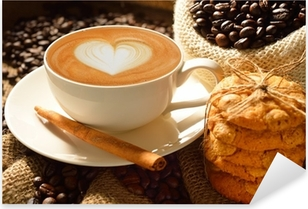 A cup of cafe latte with coffee beans and cookies Pixerstick Sticker