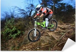 A young man riding a mountain bike downhill style Pixerstick Sticker