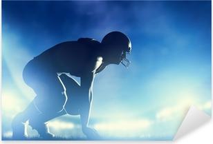 Pixerstick Sticker American Football spelers in het spel. lichten van het stadion