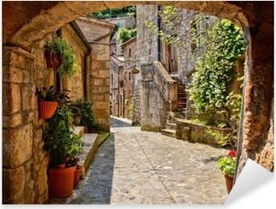 Arched cobblestone street in a Tuscan village, Italy Pixerstick Sticker