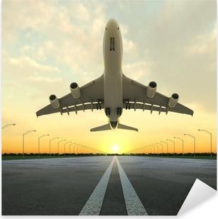 Sticker Pixerstick Avion au décollage à l'aéroport au coucher du soleil