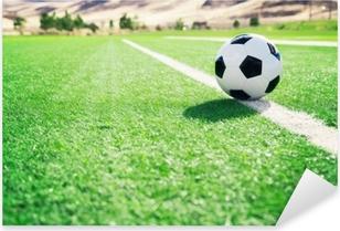 Sticker Pixerstick Ballon de foot sur un terrain de football