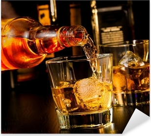 barman pouring whiskey in front of whiskey glass and bottles Pixerstick Sticker