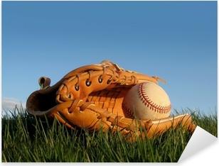 Baseball glove with ball resting in a grass field Pixerstick Sticker