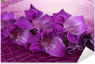 Beautiful gladiolus flower in water on purple background Pixerstick Sticker