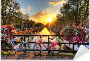 Beautiful sunrise over Amsterdam, The Netherlands, with flowers and bicycles on the bridge in spring Pixerstick Sticker