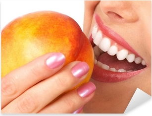 Beautiful young woman eating a peach. Isolated over white. Pixerstick Sticker