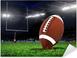 Sticker Pixerstick Boule de rugby sur l'herbe dans un stade