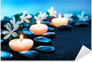 candles and black stones on black mat Pixerstick Sticker