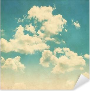 Sticker Pixerstick Ciel bleu avec des nuages dans le style grunge.