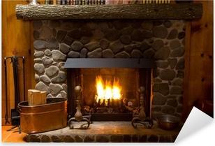Sticker Pixerstick Close-up de la cheminée en pierre cabane en rondins avec une flamme de feu