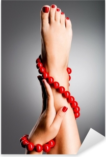 Closeup photo of a beautiful female feet with red pedicure Pixerstick Sticker