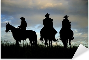Cowboys on horseback on a Montana ridge at dawn Pixerstick Sticker