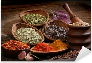 Different spices over a wood background. Pixerstick Sticker