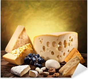 Different types of cheese over old wooden table. Pixerstick Sticker