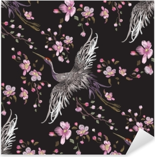 Embroidery oriental seamless pattern with cranes and cherry blossom. Vector embroidered floral patch with bird for clothing design. Pixerstick Sticker