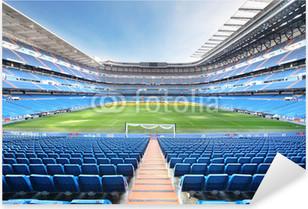 Empty outdoor football stadium with blue seats Pixerstick Sticker