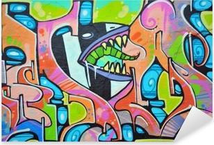 Sticker Pixerstick Graffiti coloré peint sur un mur extérieur.