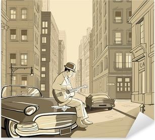 guitarist in an old street of New york Pixerstick Sticker