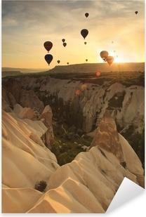 Hot air balloon over rock formations in Cappadocia, Turkey Pixerstick Sticker