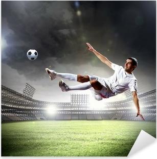 Sticker Pixerstick Joueur de football frapper la balle